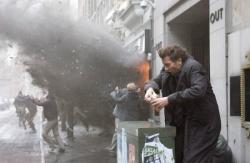 Disillusioned bureaucrat Theo (Clive Owen) tries to avoid a bomb blast   Photo Credit: Jaap Buitendijk - Children of Men