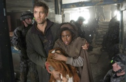 Theo (Clive Owen) and the planet´s last hope, pregnant Kee (Clare-Hope Ashitey)   Photo Credit: Jaap Buitendijk - Children of Men